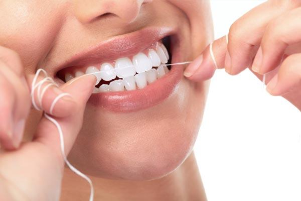 Zahnseide Pflege Zahnreinigung